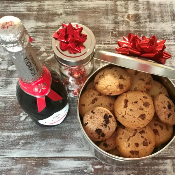 Giant Silver cookie tin with chocolate chip cookies, bubbly and jar with Lindt truffles